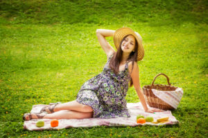 The beautiful woman in a dress on picnic